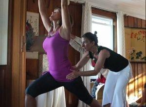 Dina assisting a yogi