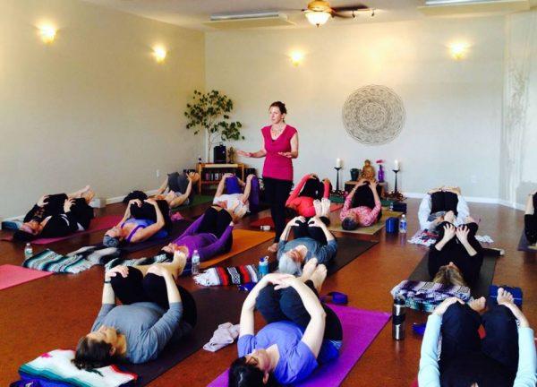 Dina teaching a yoga class
